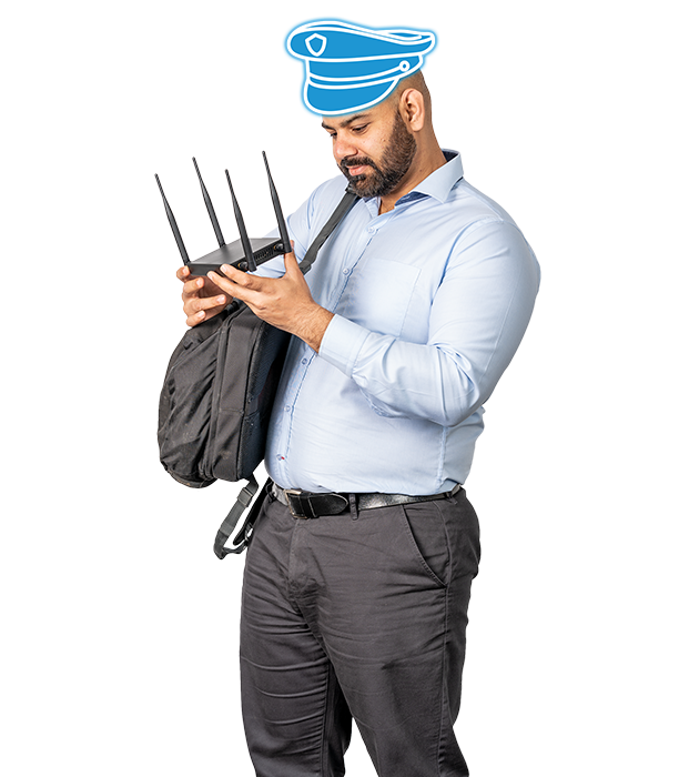 Network Security.  A man works with a security testing device to test the security of a client's network.