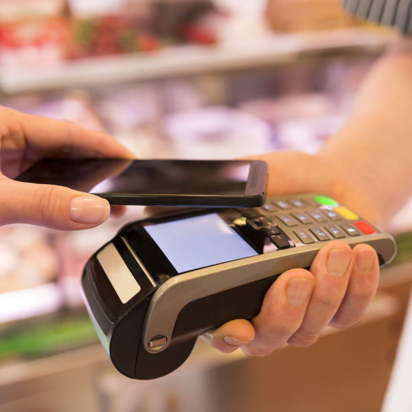 Retail IT Support. a mobile EFTPOS scanner accepts a card transaction
