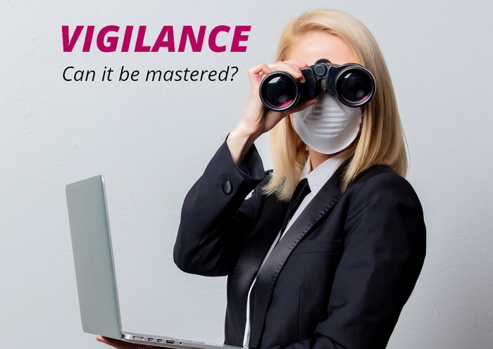 Managed IT Services - a vigilant woman inspects her PC with binoculars